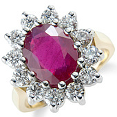 Oval Ruby and Diamond Claw Set Cluster Ring